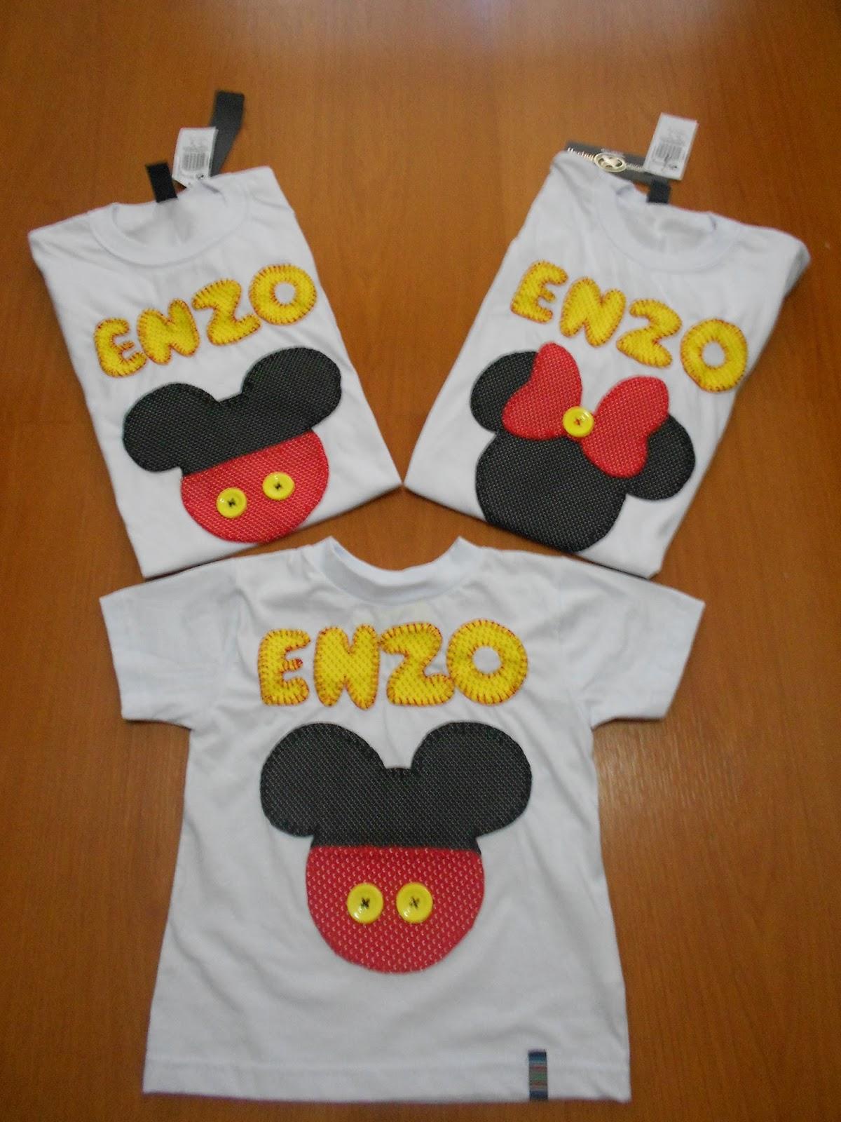 ccfc9f78ac As camisetas contem o nome da criança o desenho da minnie ou mickey e o nº  atrás com orelhinhas.