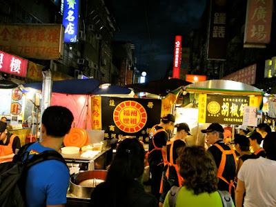 Queue for black pepper bun Raohe St Night Market Taipei