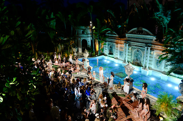 aerial view of Versace pool at night for Swim Week