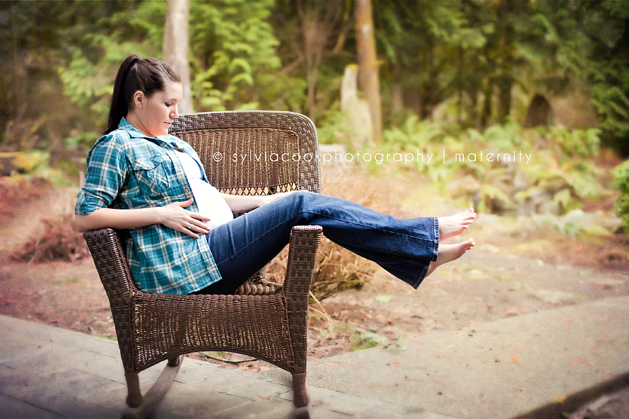 pregnant woman sitting in wicker chair
