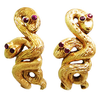 Vintage 1980's gold snake earrings with ruby eyes.