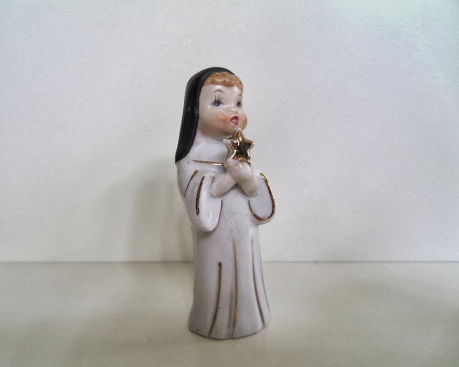 https://www.etsy.com/listing/181872173/vintage-ceramic-nun-figurine-holding