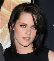 Kristen Stewart with ugly smirk sneer frown wasted drugged out
