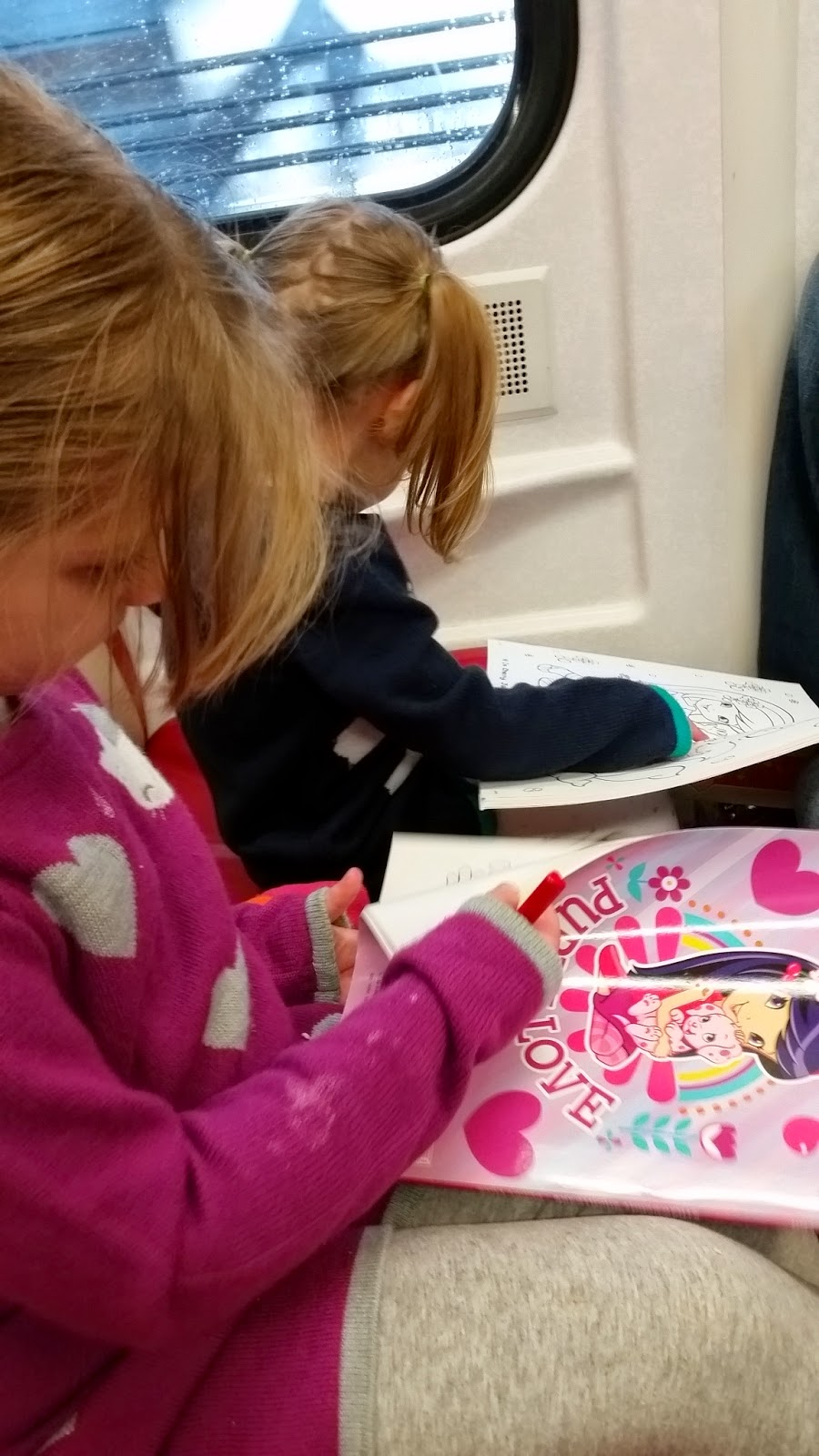 4 year old and 2 year old on train coloring