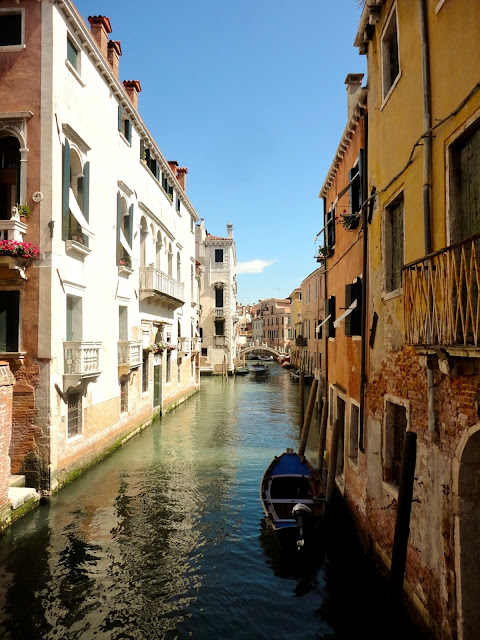 Canal and gondola in Venice, Italy