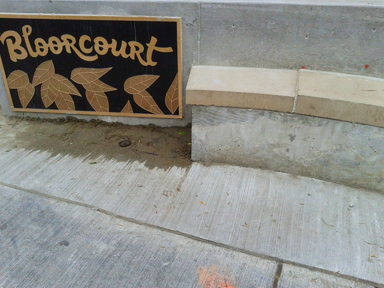 Bloorcourt sign at Dufferin and Bloor (bench)