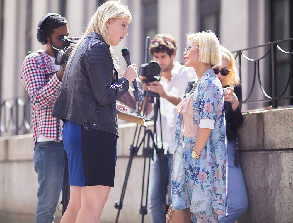 Crystal Phuong interviewed with a local media outside Skylight Monyihan Station- New York Fashion Week 2015
