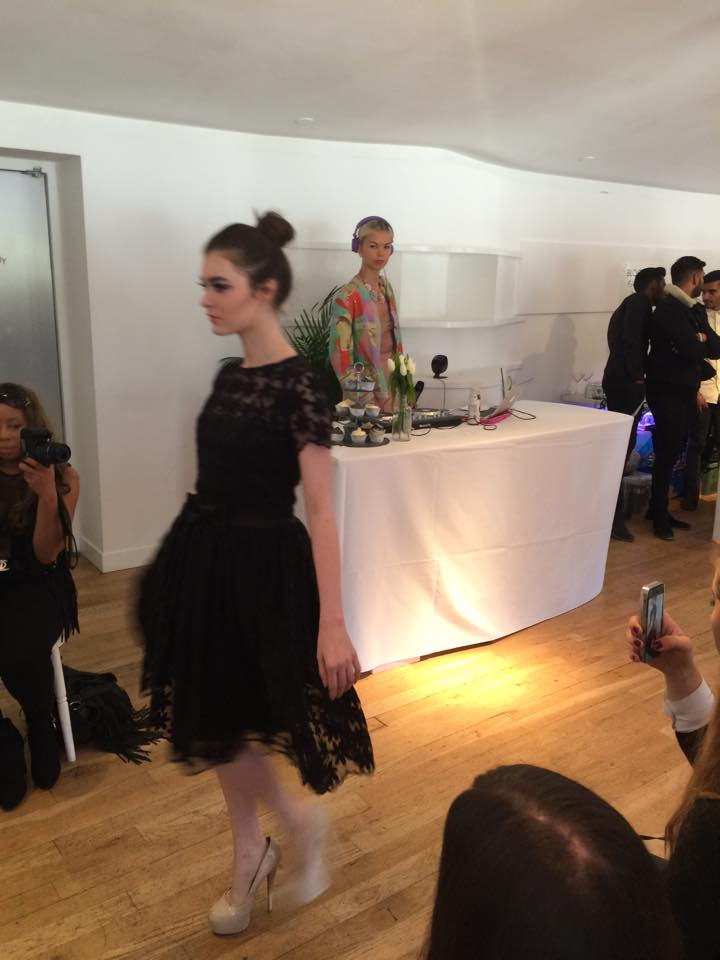 Georgina Dee, black dress, catwalk show, runway, model, fashion week