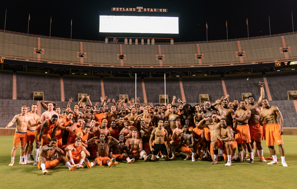 2014 Tennessee football team poses (mostly) shirtless in Neyland Stadium.