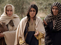 a photo of Mary Magdeline going to the tomb of Jesus with two other women one on each side of her, courtesy of freebibleimages.org