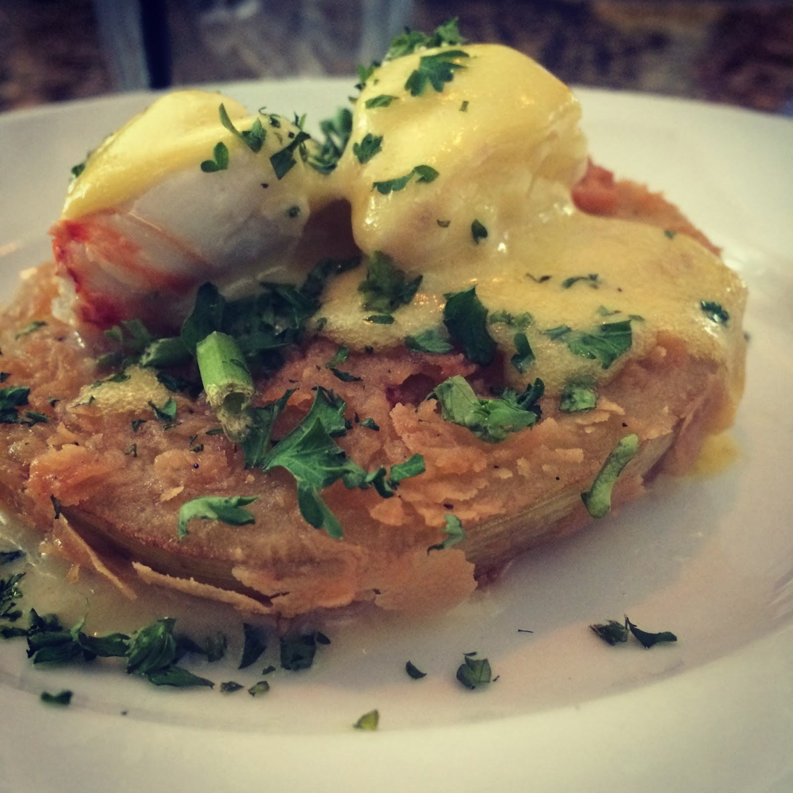 Fried Green Tomatoes with Lump Crab Meat and Hollandaise  at The Little Viallage