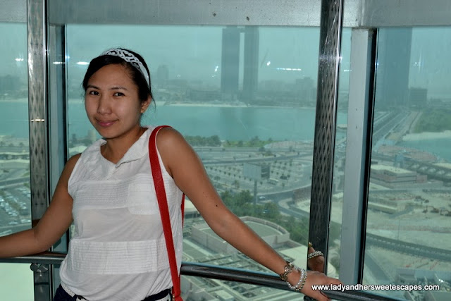 Lady at Marina Mall Abu Dhabi Sky Tower's elevator