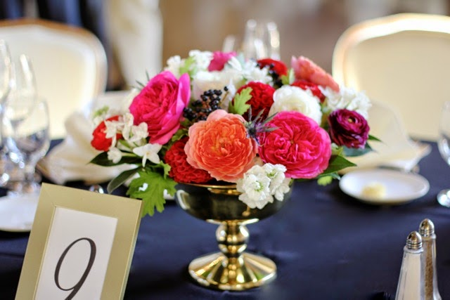 Guest table centerpiece by Sweet Pea Floral Design Detroit Grosse Pointe featuring romantic antike garden rose baroness garden rose red ball dahlia white narcissus plum and red ranunculus in a gold compote for Grosse Pointe Yacht Club fall wedding
