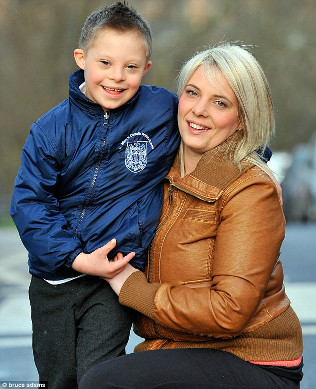 Clare Ellarby, hurt when her Down Syndrome child was denied to attend First Holy Communion