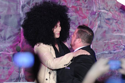 Cher greets Chaz with a hug