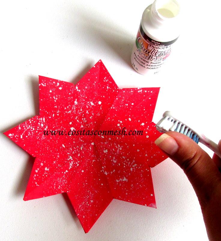 Guirnalda navide a con estrellas de papel y copos de nieve for Estrella de nieve