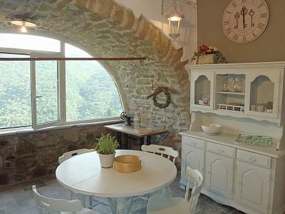 Arredamento country cucina in pietra country for Arredamento in pietra