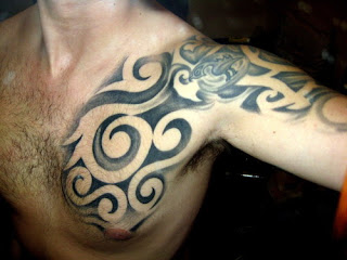 Cool Tribal Tattoo on Chest and Arms