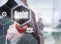 "image of a person in front of a virtual computer screen touching link to ""assist"""