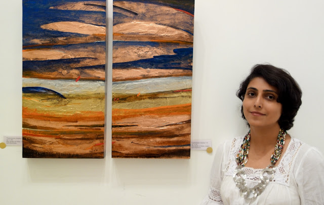 """Ami Patel with two of her beautiful creations titled """"Transitional Journey"""" ( see these creations in the featured exhibition of Ami Patel's works on www.indiaart.com)"""