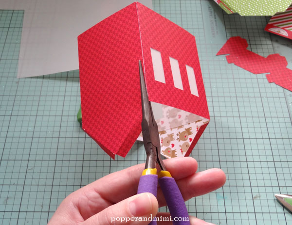 Use needlenose pliers to press together glued seams.  Works like a charm!