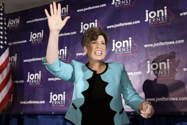 State Sen. Joni Ernst waves to supporters after winning the Republican nomination for the U.S. Senate. (Credit: AP / Charlie Neibergall) Click to enlarge.