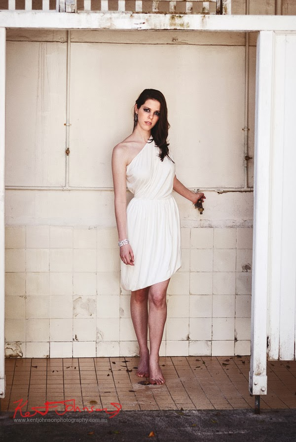White off shoulder Bridal dress, women's change room location - Fashion photographed by Kent Johnson.