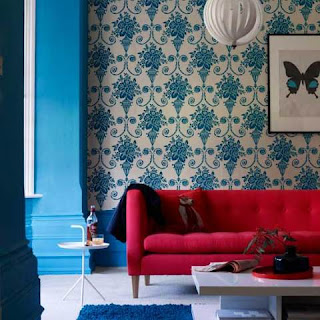 Turquoise Pattern Wallpaper and Red Sofa