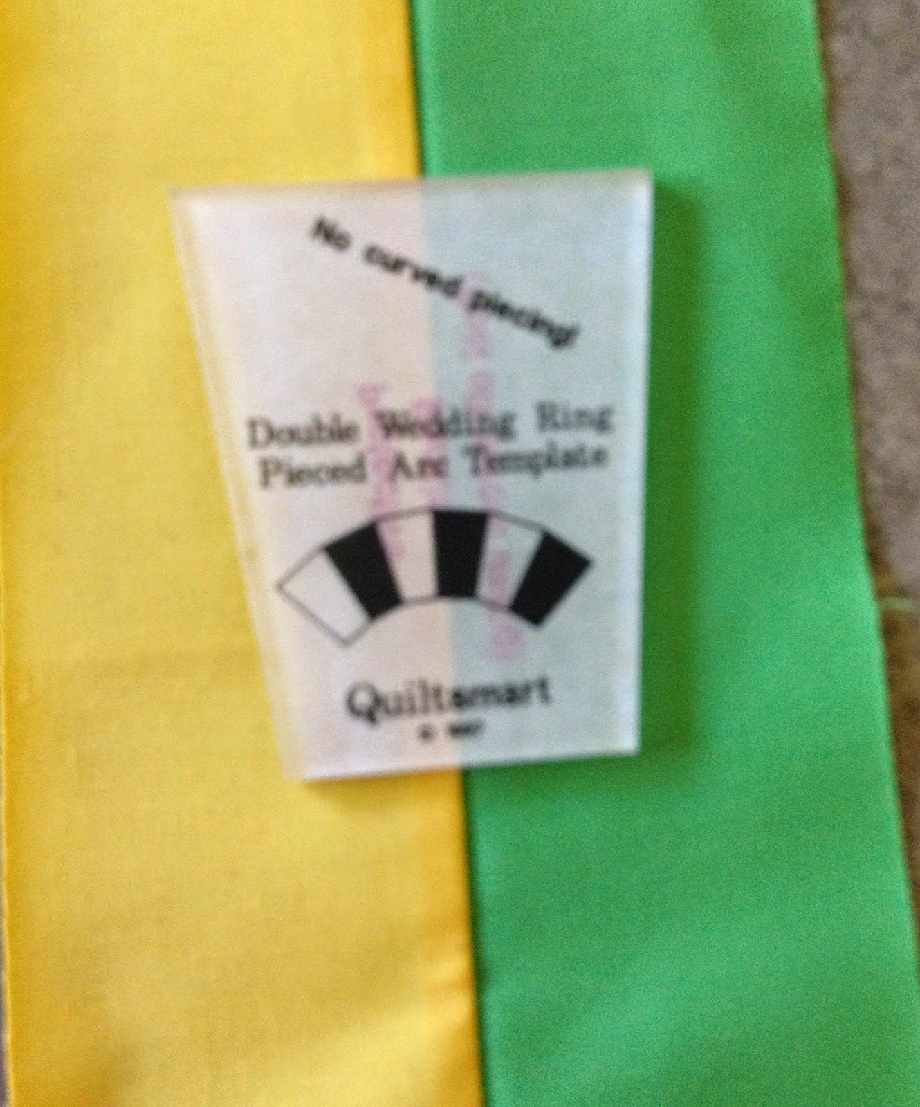 quiltsmart double wedding ring template with pieced fabric