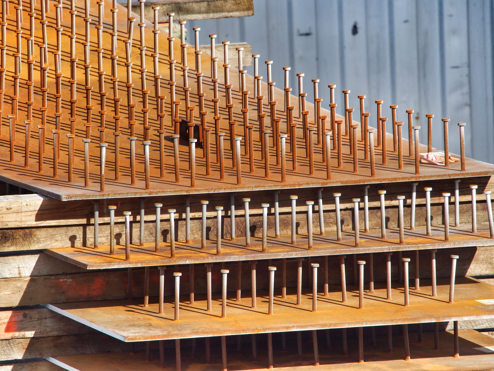 Nails in a Row #nailsinarow #construction #nyc #hudsonyards #steelplates #nails ©2014 Nancy Lundebjerg