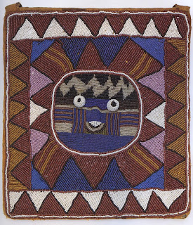 One of a pair of nineteenth century dance panels, worn by a Yoruba priest or priestess at the time of an annual festival and made of locally woven cotton cloth and imported European glass seed beads. The faces that appear on many beaded bags or panels are conceived as images of the spiritual power of the worshiper.