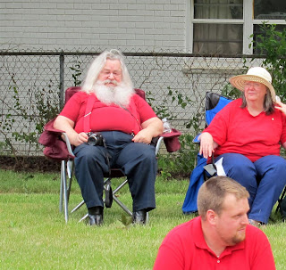 real santa clause sitting in chair at parade, redford