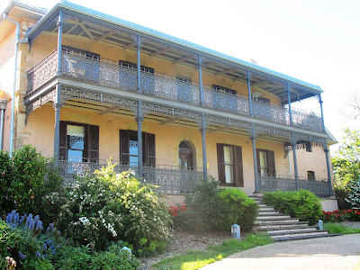 Typical two-storied traditional Australian house with iron balconies.