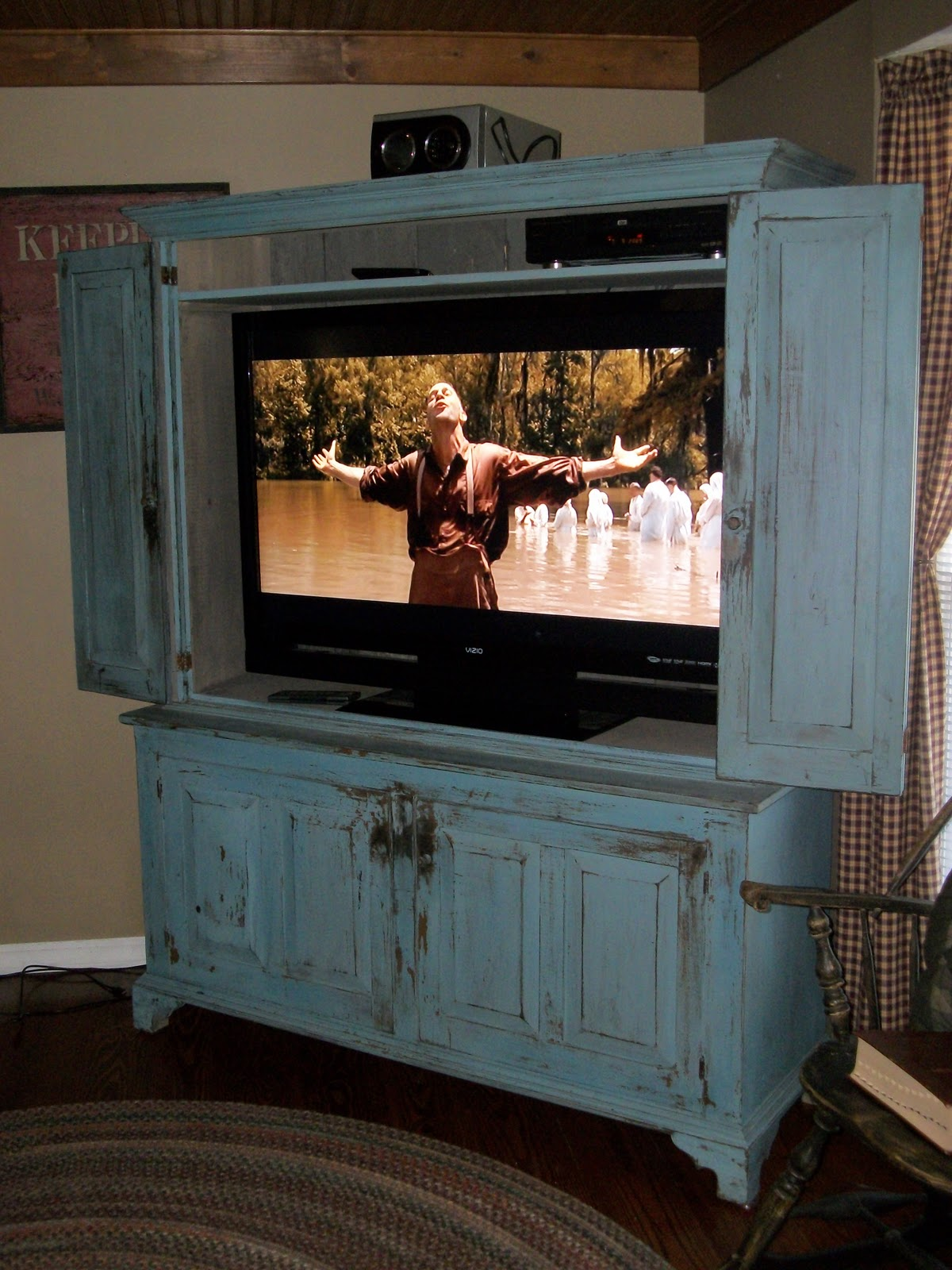 Letters from the chair flat screen tv cabinet for Tv cabinets hidden flat screens