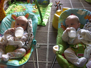 6 month twins drinking bottles
