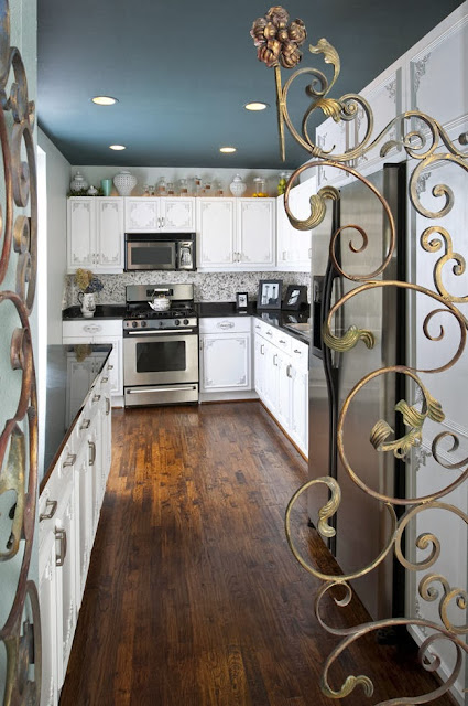 intricate chrome gate to the kitchen area