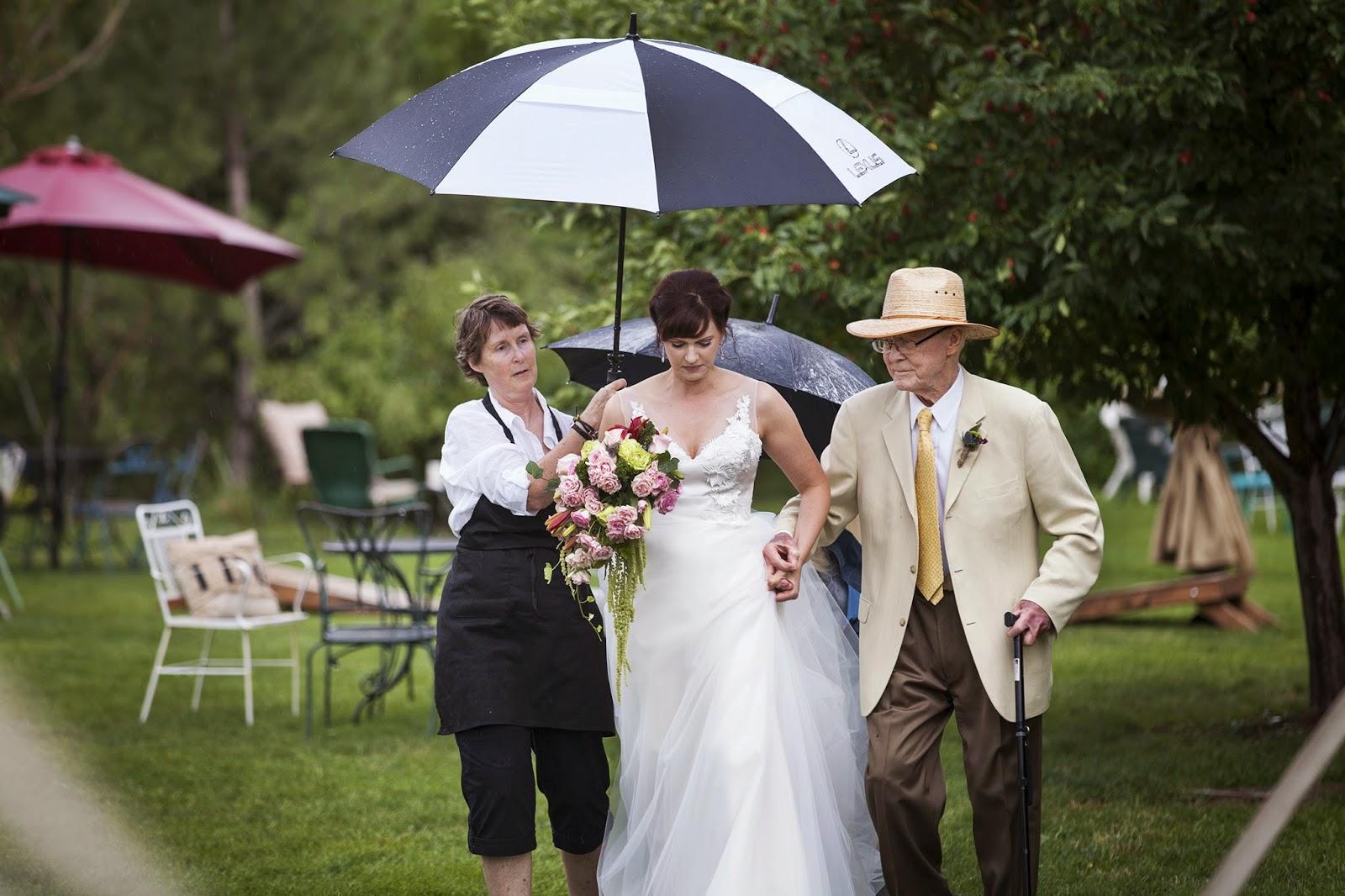 "The bride is still walking down the aisle, despite the ""rain plan"" in effect"