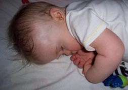 My son sleeping peacefully at six months...