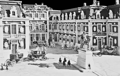 b/w image Versailles 1/48 model basic exterior with vehicles and people.