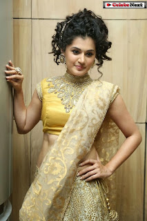 Actress Tapsee Pannu Pictures in Golden Saree at Elite Designer Fashion Show 0026