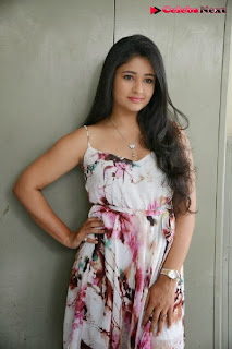 Actress Poonam Bajwa Pictures in Floral Dress at Gulf Andhra Music Awards 2013 Press Meet  0017.jpg
