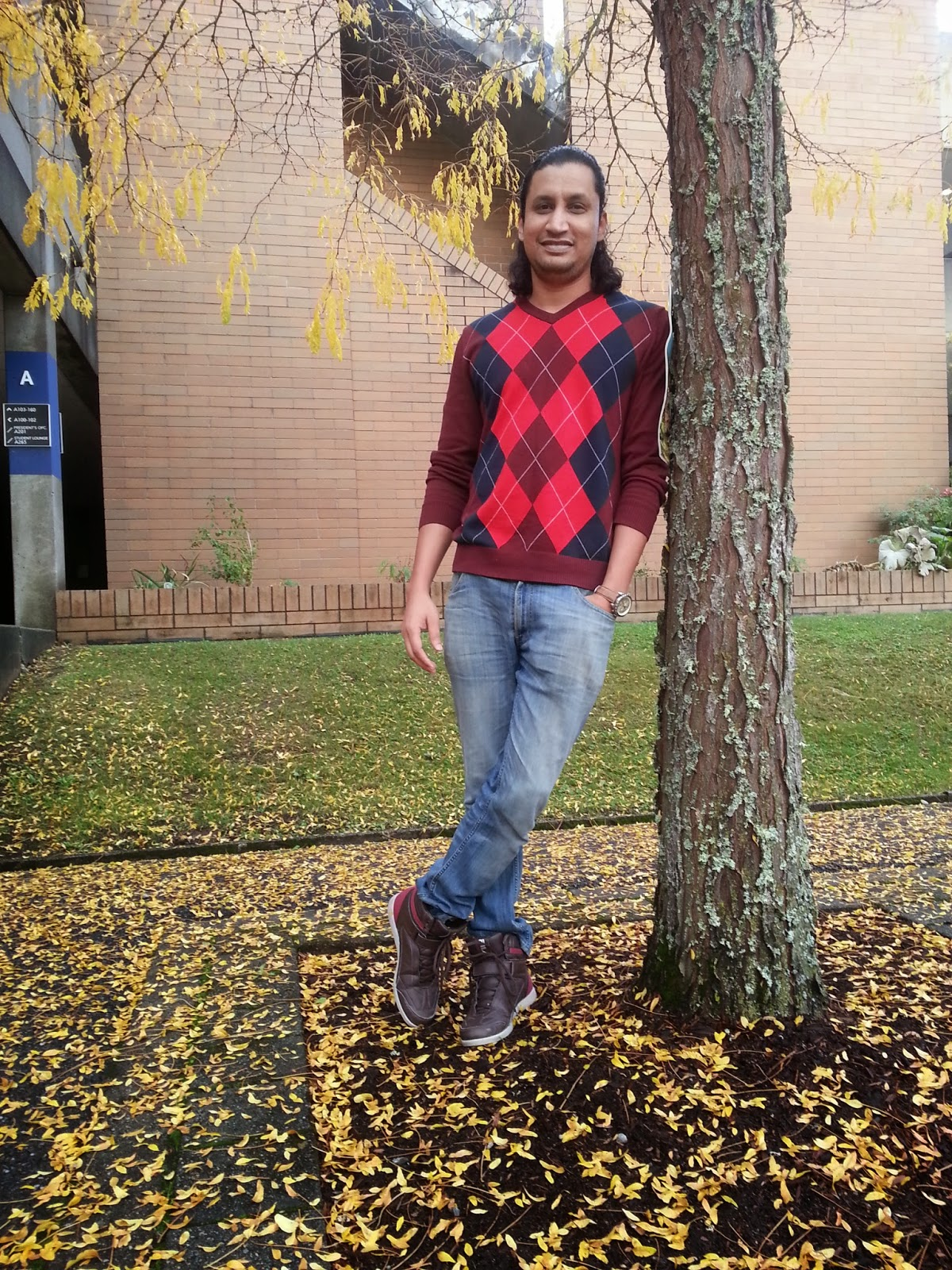 Guy wearing argyle sweater and brown boots, Indian Male fashion blogger, Indian couple fashion blogger, Argyle Sweater for men, Male fashion blogger