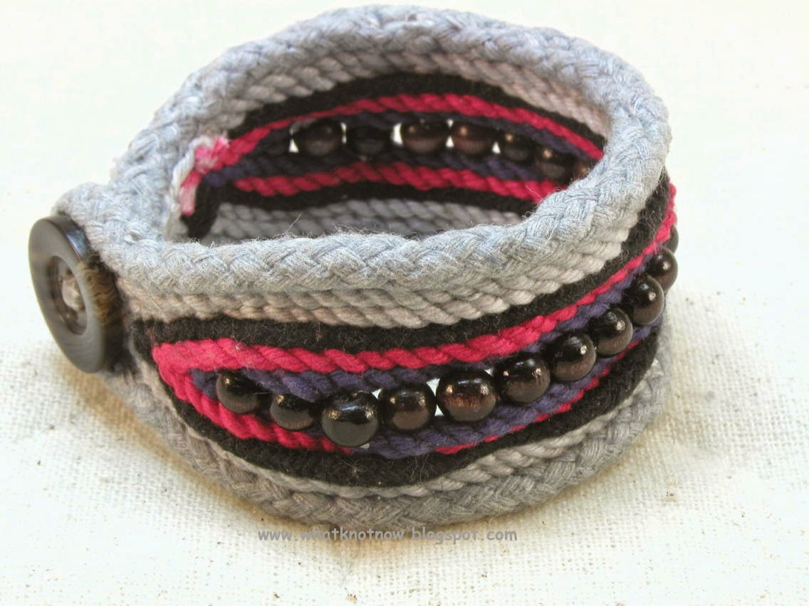 One button cuff made with grey cotton framing cord and a ...