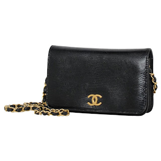 Vintage 1990's black lizard skin Chanel bag with gold hardware and chain strap.
