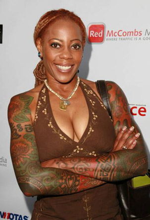 Tattooed black haired woman celebrity