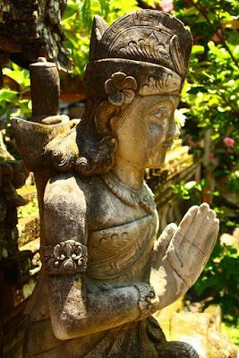 Statue of Balinese woman praying to god