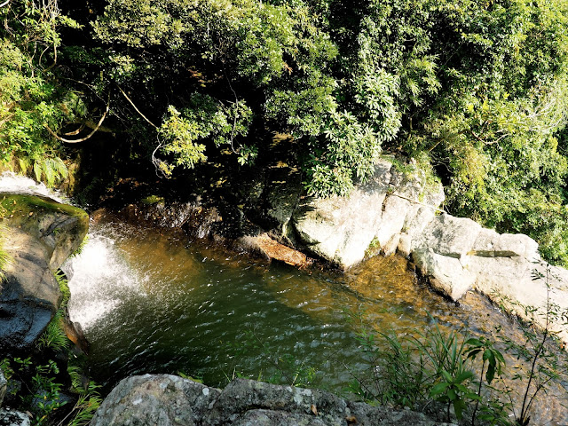 Small waterfall into the pool at the top of Mirror Pool Cascade, Plover Cove Country Park, New Territories, Hong Kong