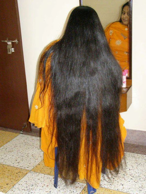 Telugu long hair girl combing infront of her dressing table