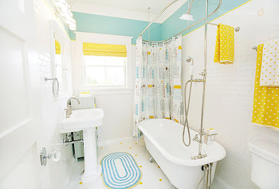 white bathroom, colorful decor, clawfoot tub.