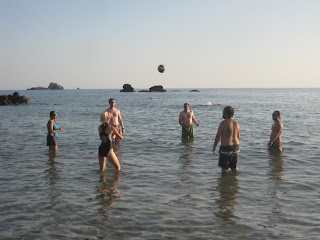 Playing with a volleyball in the water at Pelekas Beach